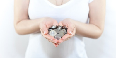 Girl with coins in her hands